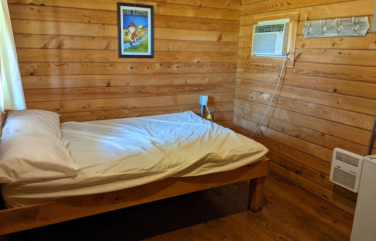 """""""Rowan"""" Camping Cabin #4 is a basic camping cabin, a step up from pitching your tent.   Stay coze and dry at night, beds are camping style, bring your bedding, pillows or sleeping bags."""
