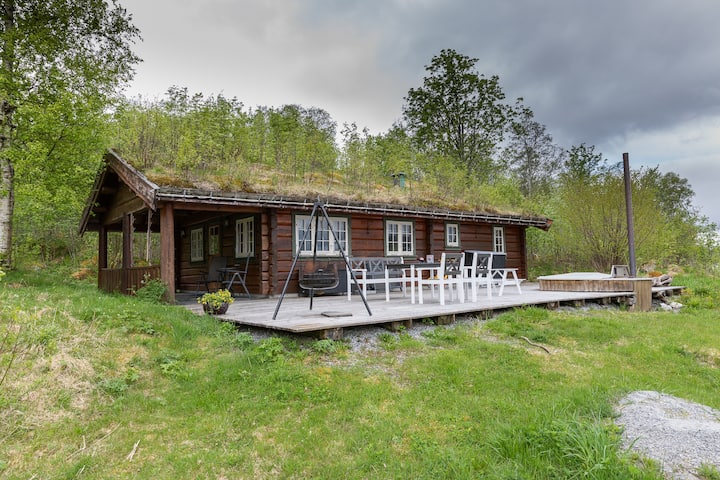 cozy timber log by the fjord with hot tub