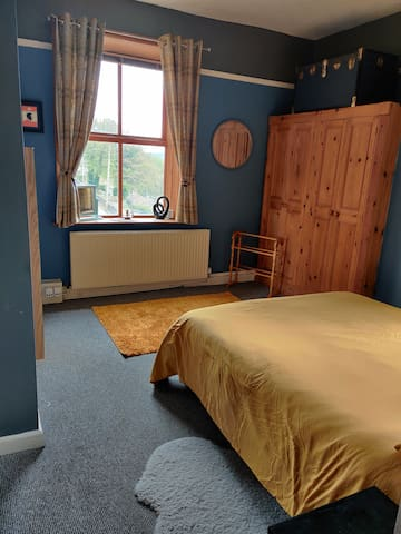 Spacious bedroom.  Double bed etc