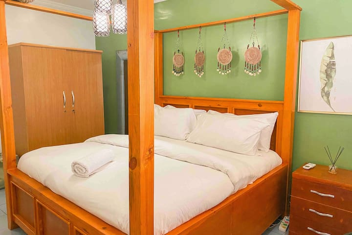 """Master bedroom with a Zanzibar-styled bed. This is bed is 6""""X6"""" & fits two people perfectly."""