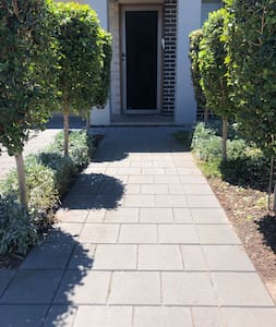 Path way to the front door.  You can also enter into the home via the garage as there is  internal access.