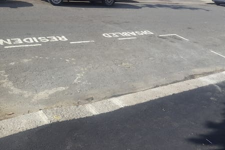 Disabled Parking Spot with a droped Curb.
