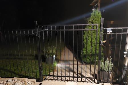 Motion sensor lighting at the gate entrance.