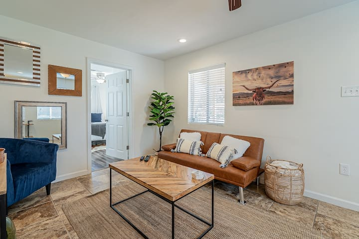 Relax in the living room with ample seating!  The couch also folds down to accommodate extra guests.