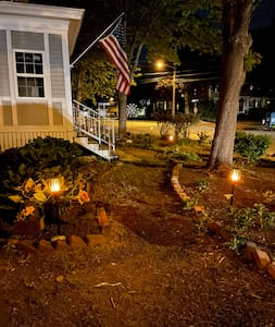 The inn has solar powered tiki torches lighting the paths surrounding the property.  There are also dusk to dawn safety lights on the stairways.
