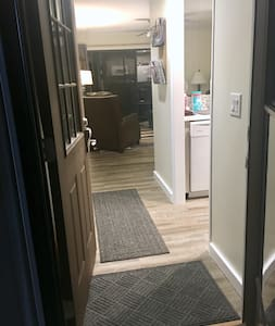 """Enter unit through 36"""" door directly to living and kitchen without other doors."""