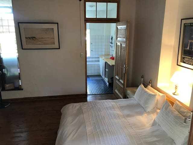 Main bedroom with ensuite full bathroom. Please note: no air-conditioning, house is always temperate due to thick clay walls.