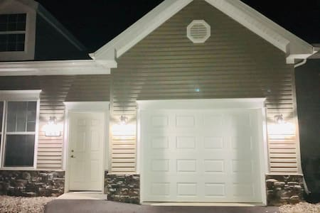 Three exterior lights on short level driveway and front entrance. Photo taken at 9 PM at night