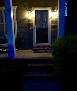 There is a curb and 3 steps leading up to the porch and then another 2 steps to get into the house.