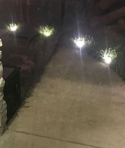 We have lights along the front walkway and usually have the porch light on as well.