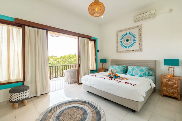 Upstairs bedroom with balcony and a view