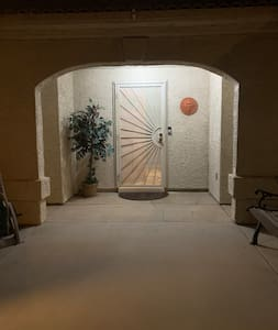 Entrance to my home. Lighted. Also has security door and RING camera for both our safety and security.