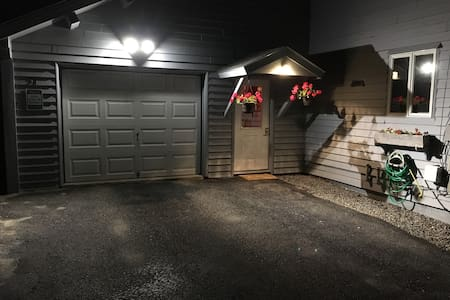 Light over entrance stays on. Light over garage is motion activated.