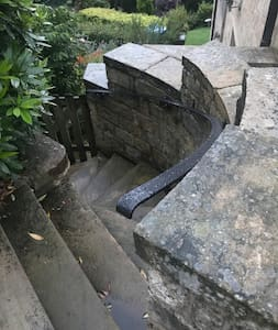 There is a small stone staircase and gateway leading to the Bunker. There is a metal hand rail along the length of the access and lights that are on a sensor for ease at night time