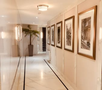 Wide flat, tiled hallways with access to the lifts to get onto each floor including basement car park.