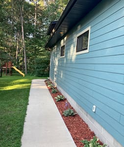 Well lit walk way that leads to the back of garage , where you will find the entrance to the retreat!