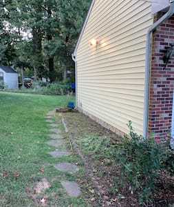 Side walk-path to private entrance to basement apartment.
