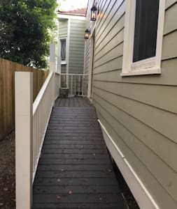 Ramp leading to front side entrance to house.