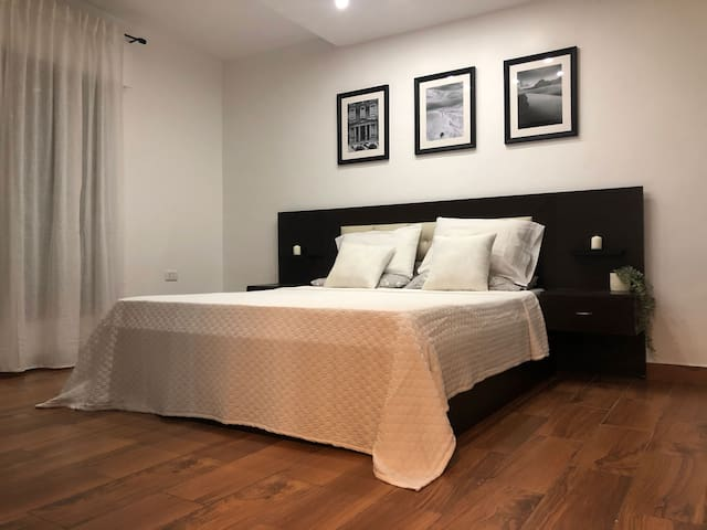 Master Bedroom - a spacious room with a king size bed and plenty of storage space.