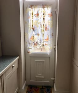 Rear door leading out from kitchen is narrow at 65cm when open.