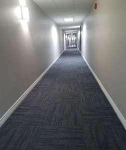 Hallway from Elevator leading to apartment entry door.