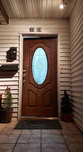 front door with sensor light at night time