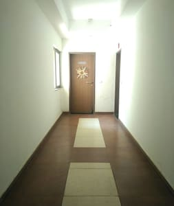 This the entrance of the house and the passage is wide enough.