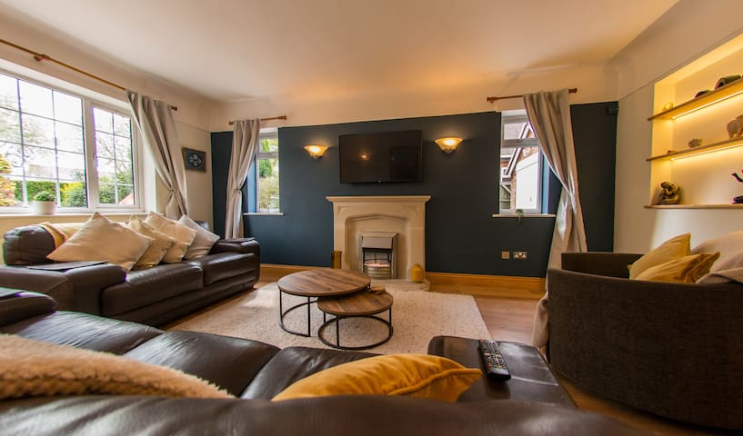 Relaxing Lounge with welcoming electric fire and TV with Netflix. IF you are in a big party, this room can be set up with 3 single beds and still serve as a lounge