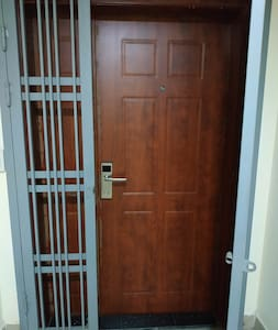 the front door of the apartment with smart electronic lock
