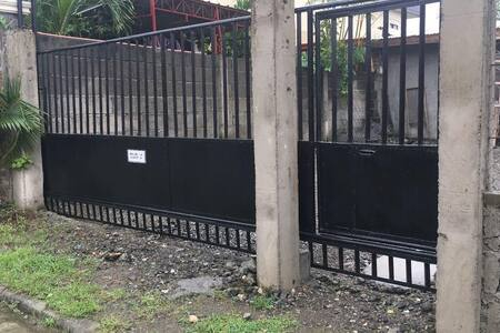 There is a gate which needs to be opened to towards the house's entrance and if the gate for the person's entry which has a step will not be possible, then the garage gate can be opened.