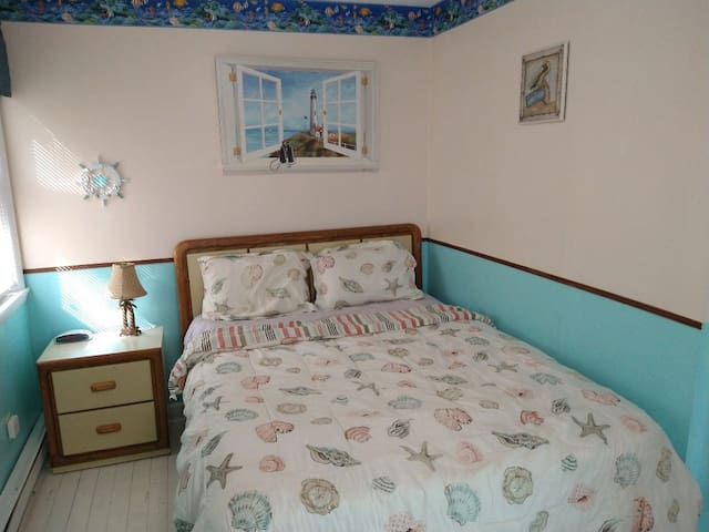 Front Bedroom w/ Queen size bed and Lucite Cool Memory Foam Mattress Topper for a comfortable rest.