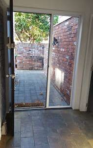 Wide, well lit  & flat entry path from driveway to front door entrance