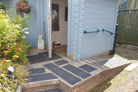 Ramp for assisted walking. Not suitable for wheelchair though, probably a bit narrow. You can see the solar lighting that lights the doorway and ramp
