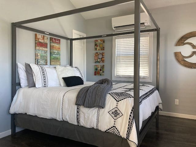 The studio cottage has a queen bed (as shown) with a single daybed, and a small double fold down futon couch all in the common room.