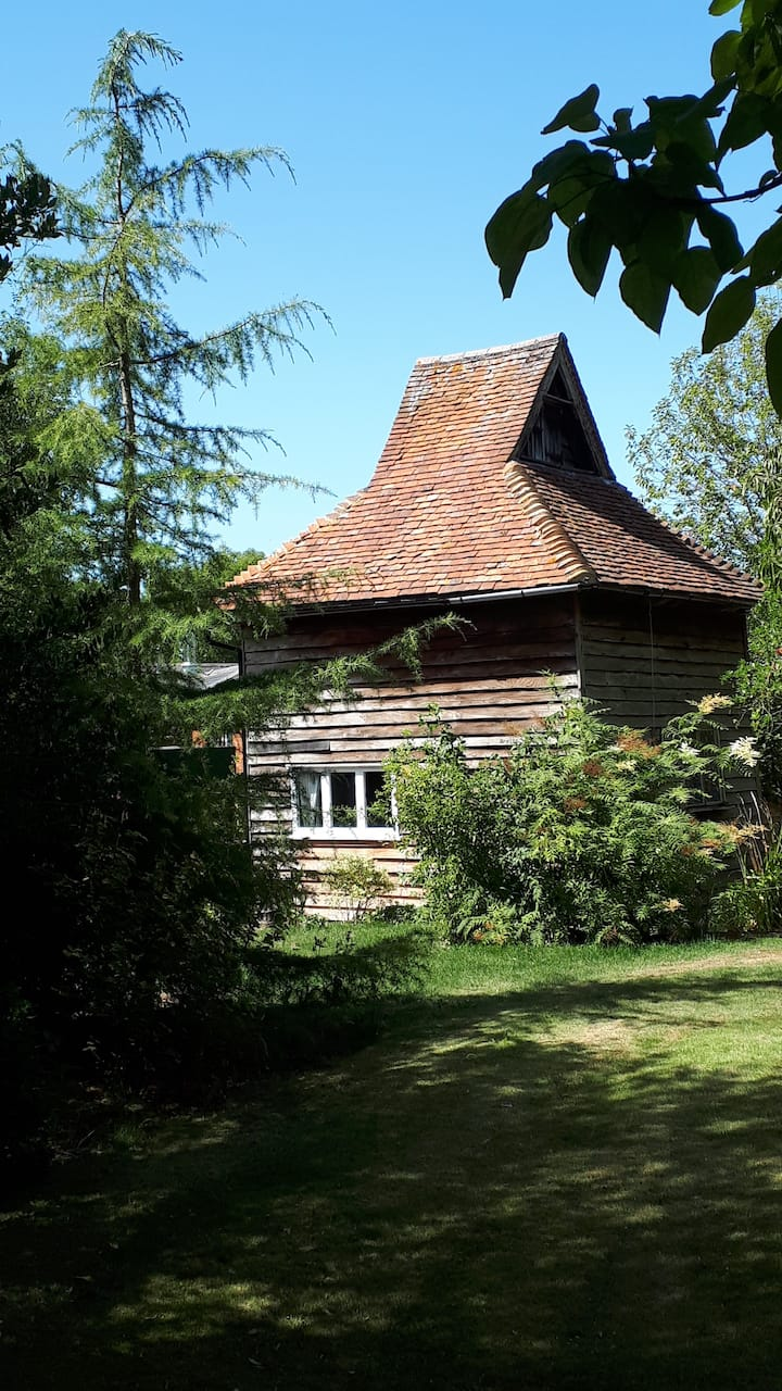Quriky Dove House in grounds of  16C Manor House.