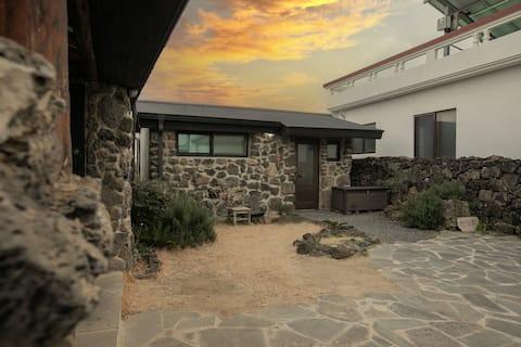 "Quiet village stone house near ""Moon Moon Moon Moon Moon"" beach. Sunrise field. (District) Spring. Small house."