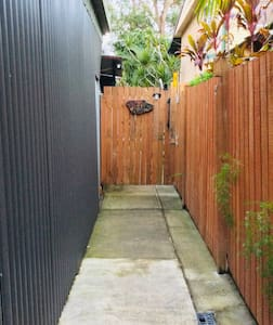 Entrance for air bnb accomodation is on the right side of the house down this path