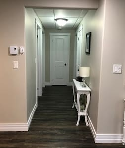 Hallway to the bathroom and bedroom.