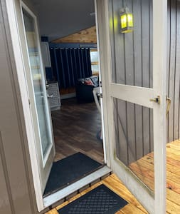 The pathway to the front door is very wide with a very slight incline.   There is a small threshold with a 36 inch wide opening through the front door.