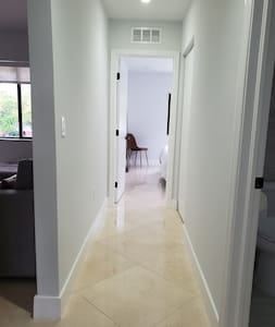 Hallway that connects two bedrooms and a bathroom downstairs