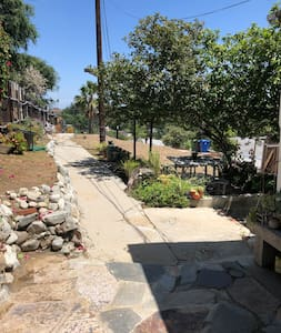 This photo shows the Pathway from parking area towards main entrance to property.