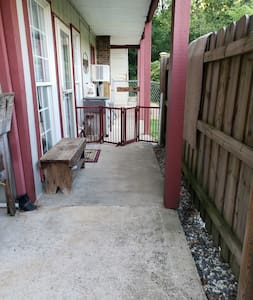 from gate to entry door across the patio