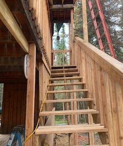 All cabins have a couple stairs to enter this photo is the main Lodge sorry we are not very wheelchair friendly with a gravel parking and driveway we are in the wilderness
