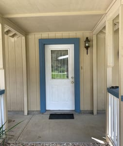 Upon entering the garage from this door, a flight of stairs allows entrance to the above-garage apartment.