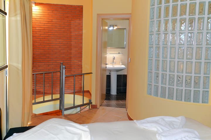 Second floor master suite with bedroom with queen bed, bathroom with Jacuzzi and two private balconies