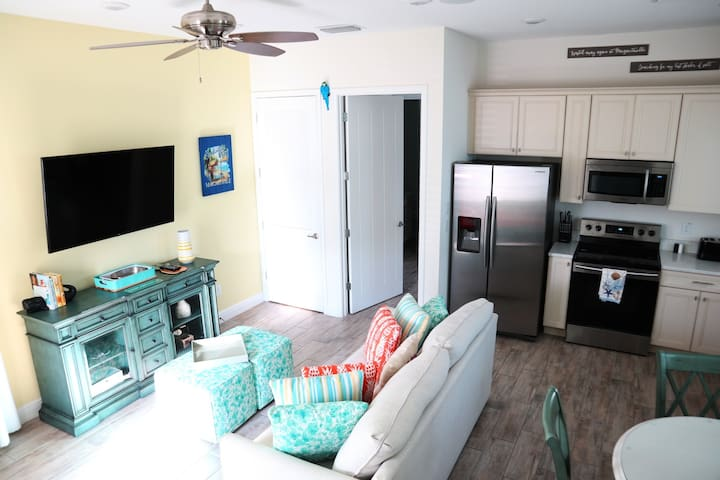 Spacious living area with full kitchen and dining area with seating for 4
