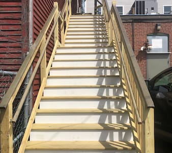 The stairs to the rear entrance have motion lights & the rear entrance has a light for our Residents & Guests.