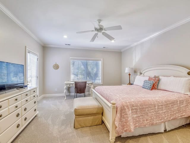 The master suite has a desk and seating area.