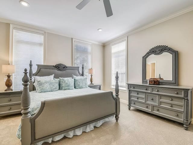 This master suite is located on the first floor. There is seating, TV, ceiling fan, large walk in closet & a large private bath. All bedrooms have a private bath.