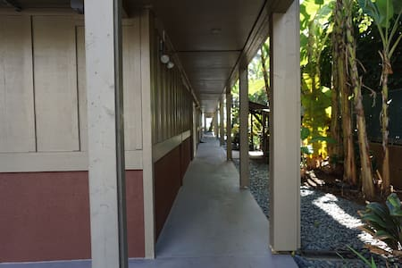 Hall leading to front door from parking lot.